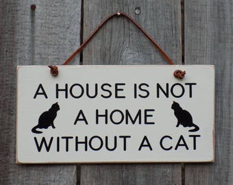 A House Is Not A Home Without A Cat, funny cat saying, wooden hanging sign, cat home decor. 3 1/2 inches by 8 inches B