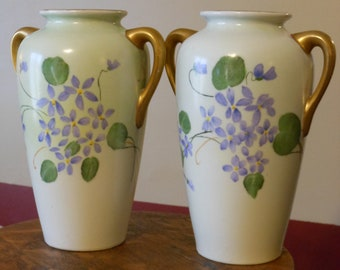 A Pair of Hand Painted Gilded Japanese Vases