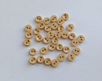 6mm Cream Buttons. 35 Buttons. Two Hole Buttons. 6mm Plastic Buttons. Tiny Buttons. Micro Buttons. Mini Buttons. 2 Hole Buttons.