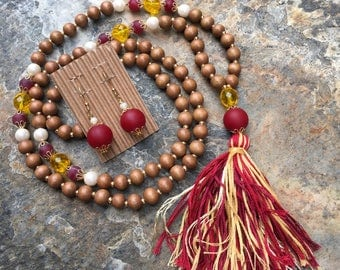 Long Beaded tassel necklace brown wood beaded necklace Bohemian necklace boho necklace garnet gold jewelry team colors Game Day