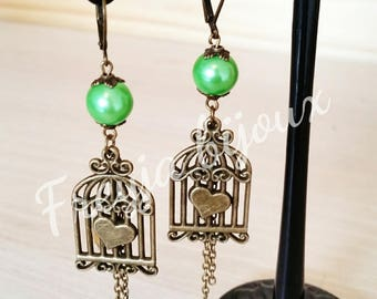Pearl Earrings green glass Pearl and bronze colored birdcage pendant