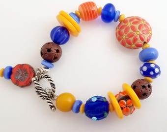 Colorful and Crazy, Wonderful Blues, Yellows and Oranges Multi Bead Styles in this Bracelet