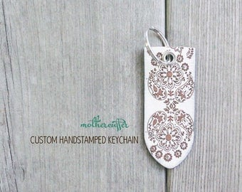 CUSTOM HANDSTAMPED white leather keychain with design by mothercuffer