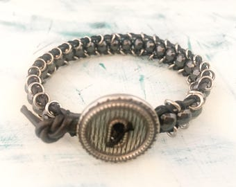 Hematite beaded leather bracelet with pewter button