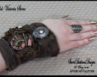 Steampunk cuff-Industrial Wrist Cuff- APOTHECARY VIAL Victorian LEOPARD Leather DieselPunk Locket Steampunk Clothing by SweetDarknessDesigns