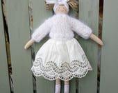 Handmade doll dressed in white. Romantic, valentine