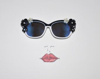 Fancy Black and White Fashion Sunglasses with frosted flowers with rhinestone centers.