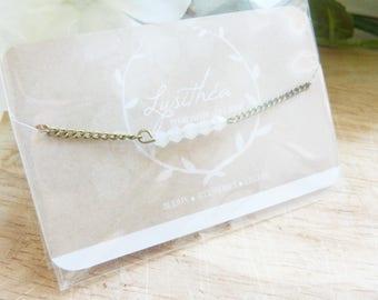 Bracelet in brass and Swarovski white pearls
