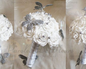 Bouquet of roses and silver white Butterfly