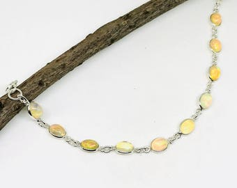 Ethiopian Opal bracelet in sterling silver 925. Length - 6 to 8 inch. Natural authentic Ethiopian opal perfectly matched.