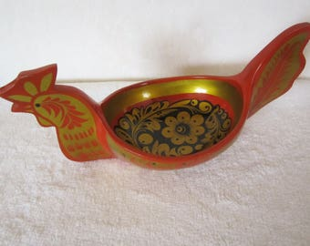 Russian Folk-Art Rooster Bowl- is wood and painted in traditional Russian style with vivid flower & foliage patterns of red, gold and black.