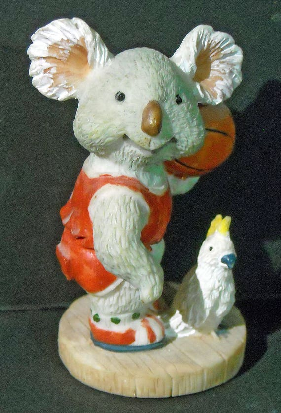 A Koala in a sports uniform with a Sulfur-crested Cockatoo from Australia: Cuteness Overload