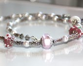Pink pearl necklace, glas...
