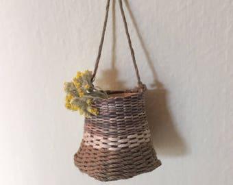 Miniature hand woven multi color basket