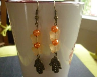 Pearls, butterflies and hand of Fatima earrings.