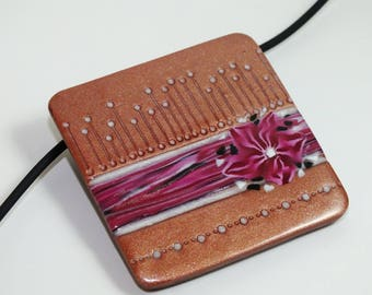 Pink square pendant with flower