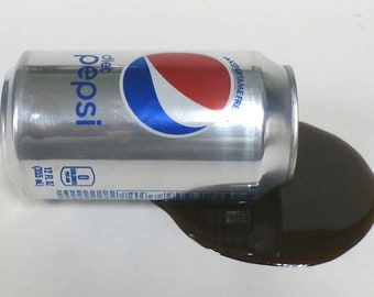 fake food spilled can of diet pepsi