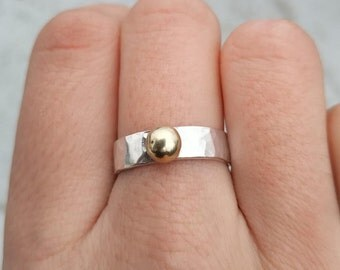 B002 Hammered silver ring with brass pebble