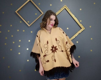 70s Beige wool poncho with fringe and embroidery