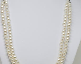 Gorgeous multi strand faux pearls necklace