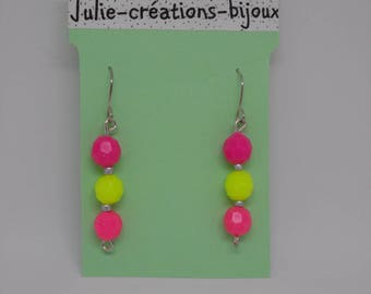 Earrings made of plastic and seed beads
