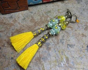 Boho earrings / green and yellow Bohemian, artisan Lampwork, tassels and bronze metal beads.