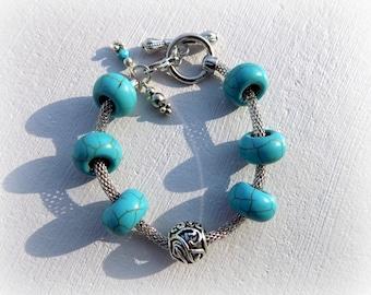 Turquoise, antique silver snake bracelet.