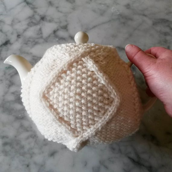 Teacozy: handknit Aran diamond tea cosy. Original design. Made in Ireland. Knit teacosy available in white or pink. Great gift for new home.