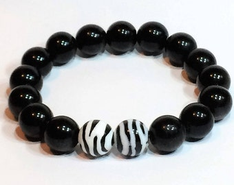 Black beaded stretch bracelet, zebra print accent beads, one size, African theme, black & white, unique jewelry gift for her, gifts under 25