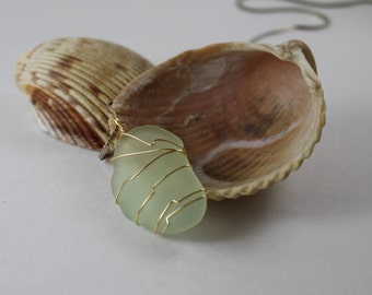 Light green sea glass pendant with gold wire wrapping