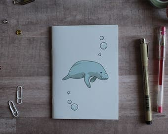 NOTEPAD. A6 Cute Manatee Notepad. Soft 300 gsm Card Cover. 40 blank pages. Matte lamination pleasant to the touch.