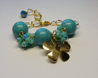 Turquoise bracelet with gold details