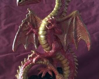 The sun dragon figurine  by wizzard emporium