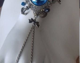 Turquoise and dark blue dragon's eye, anchor and shell, turquoise tear