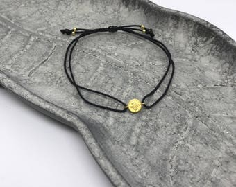 Bracelet with golden coin