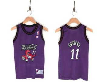 90s Toronto Raptors Isiah Thomas Champion NBA Jersey. Vintage 90s Isiah Thomas Toronto Raptors NBA Basketball Champion Jersey.
