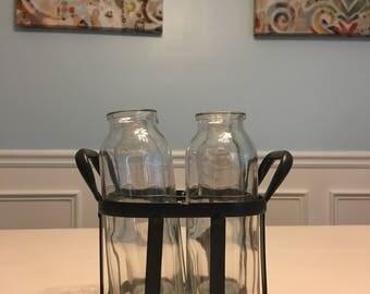 Milk jars in blue metal basket