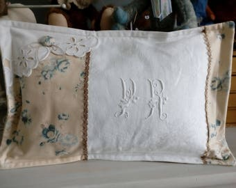 Shabby, flowered cotton and old style cushion