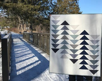 custom baby quilt | Ascent Quilt | modern baby quilt | design your own quilt | flying geese quilt | modern toddler quilt | grey quilt