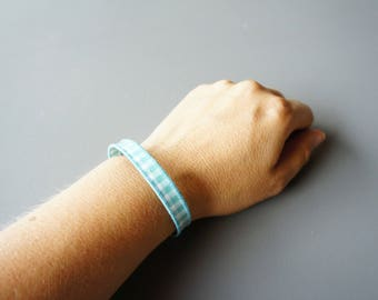 coated cotton and metal bracelet
