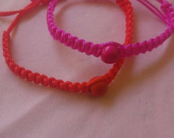 Coloured macrame friendship bracelet with bead