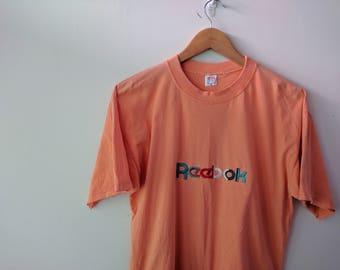 Vintage 90s Reebok Spell out Logo orange pastel T-Shirt