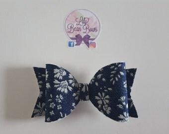 Denim daisy bow made using Liberty of London fabric