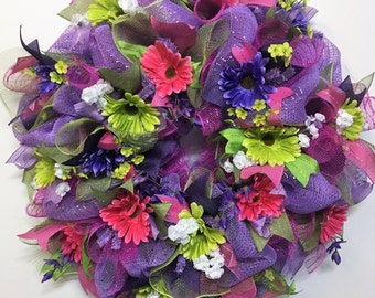Beautiful purple full mesh wreath with flowers for your door.