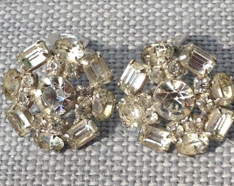 Vintage Kramer round floral Rhinestone clip on silvertone Earrings circa 1950's.