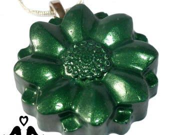 Green lustre flower pendant on silver plated snake chain.