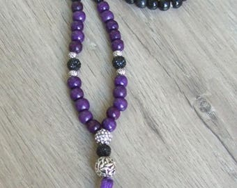 Purple and black beaded ladies necklace with antique silver and bling