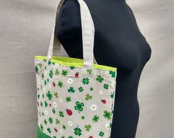 Small Cotton Shopping Bag with Modern Four-leaf clover Flower motive in Green and Beige combination Lines
