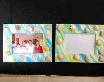 Two similar shell picture frames painted with blue, green, yellow, and white background, beachy, nautical, personal, friends, family, decor