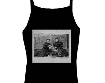 Women in Mourning black tank with spaghetti straps. Victorian Mourning dresses on two women at tea party photo